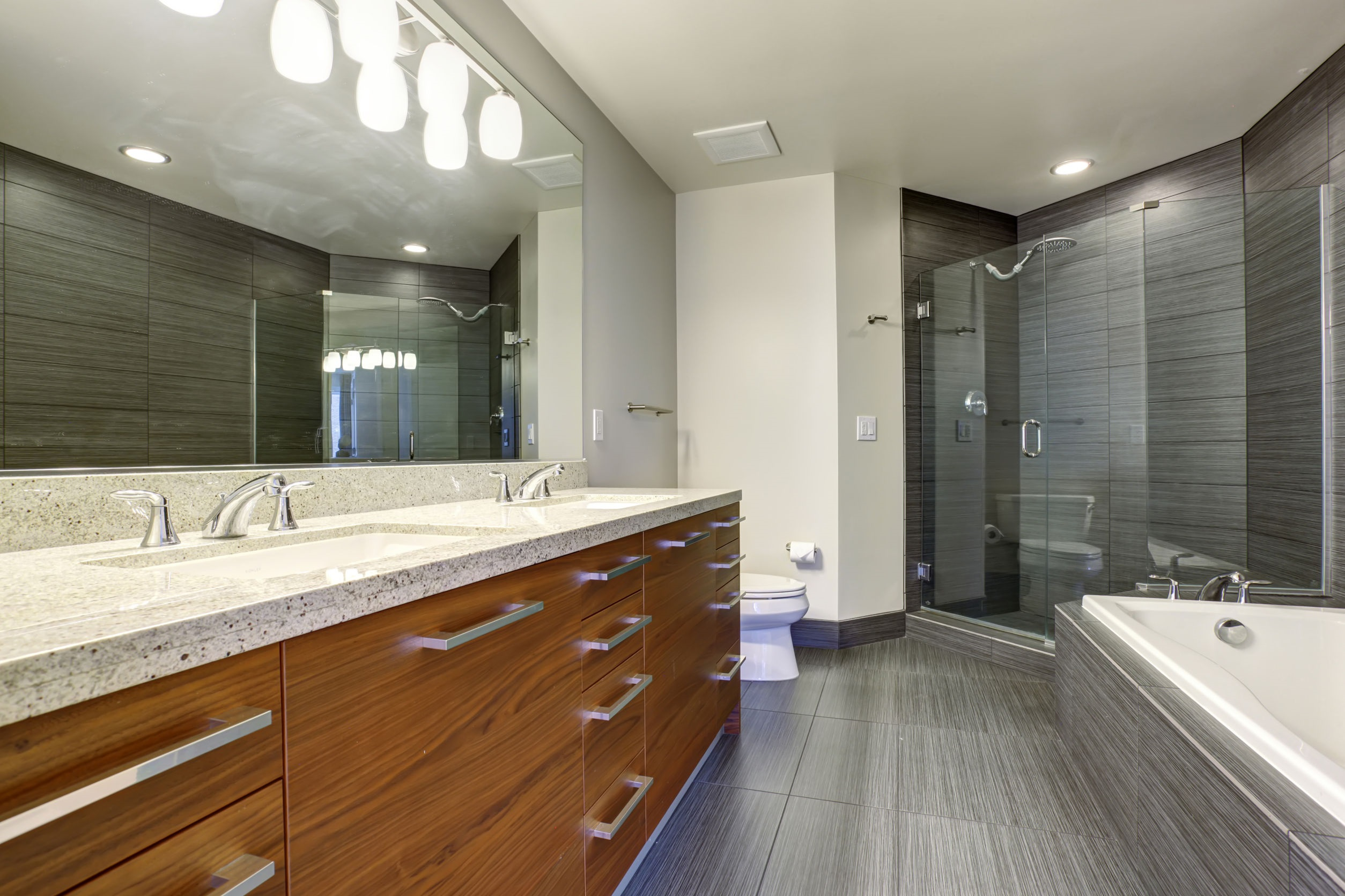 Modernized bathroom olson plumbing heating co for Bathroom floor trends 2016
