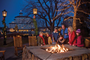 Family making smores over gas fire pit at The Broadmoor © Kevin Syms